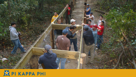 NSU Pi Kapps build boardwalk at George camp for people with disabilities