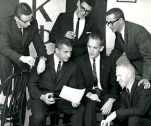 Former archon George Cameron holding the original Beta Omicron chapter gavel in 1963.