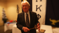 Founding archon Jack McCain, Jr. (#1) holding the Beta Omicron chapter's original gavel in April 2015.