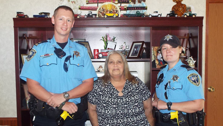 St. John Parish Sheriff's Office Lt. Jason Raborn, Judy Ferraro and Deputy Lisa Dorris.